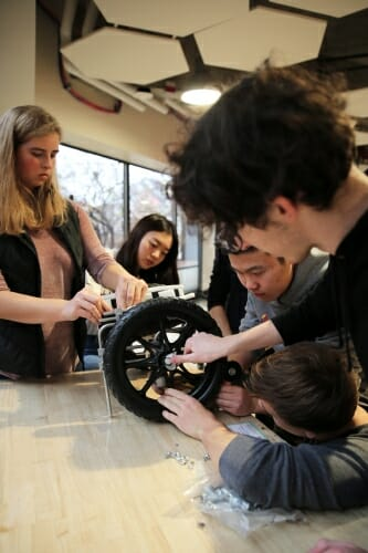Photo: Students work on a dog wheelchair.
