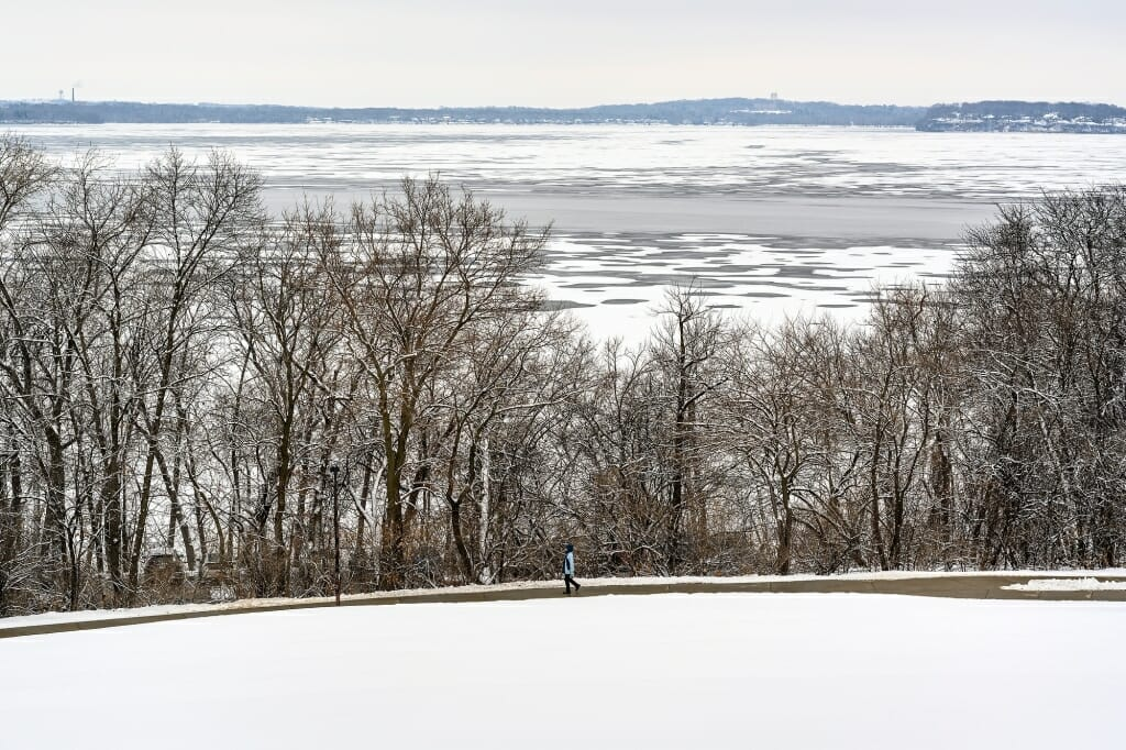 Photo: View from a hilltop of Lake Mendota partly frozen, partly open