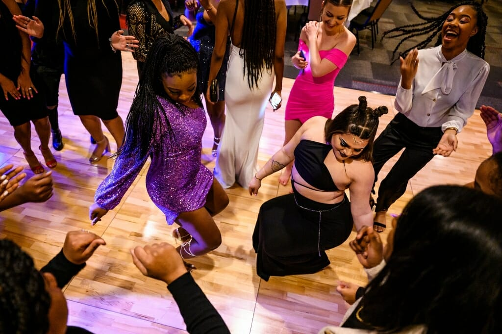 Two students dance on the dance floor.