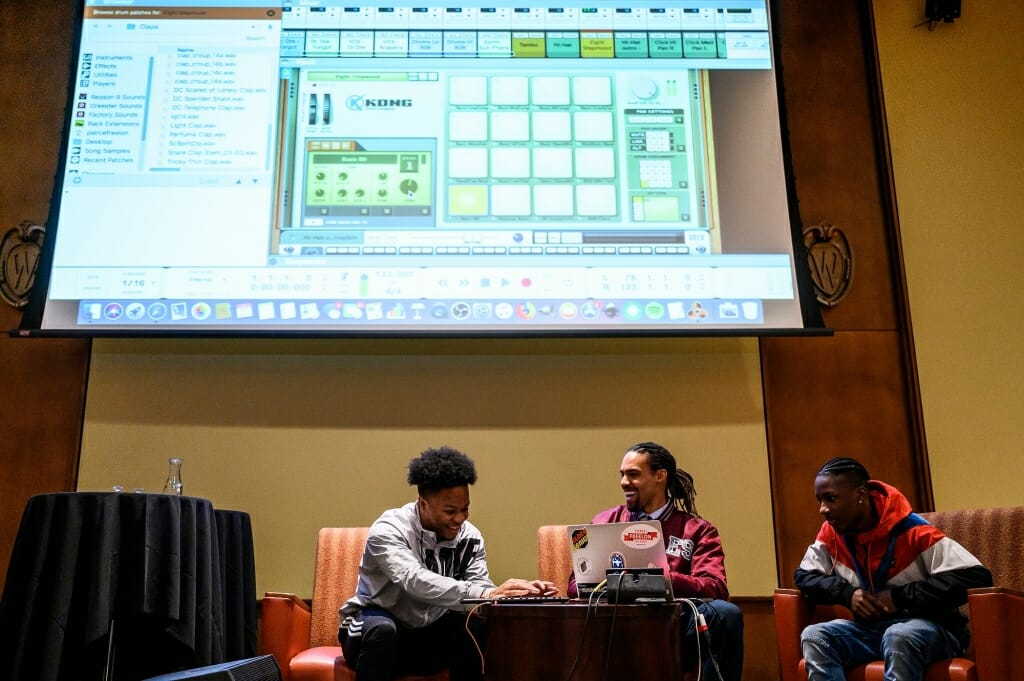 Freelon leads a freestyle beat-making session with Shannon Jones II, at left, and De'Aire Reed, at right.