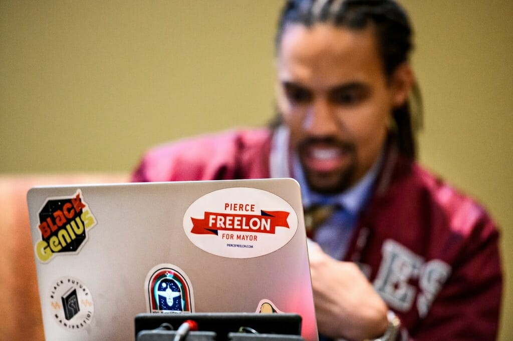 A sticker on keynote speaker Pierce Freelon's laptop computer referred to his experience in 2017 running for mayor of the City of Durham.