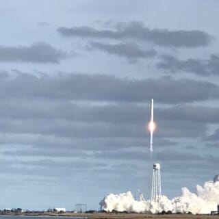 A rocket lifts off Saturday from NASA's Wallops Flight Facility in Virginia, carrying the tubes of bacteria and phages.
