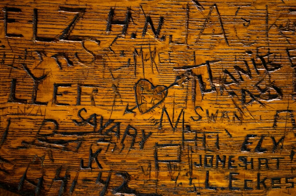 Cupid has clearly visited this vintage wooden table at the Memorial Union's Der Rathskeller.