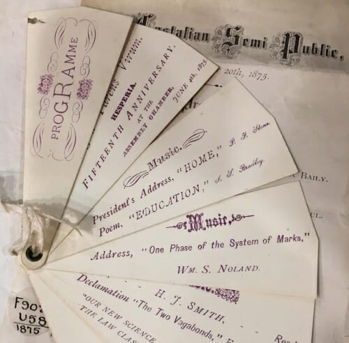 Display of slips of paper with titles of commencement program entries