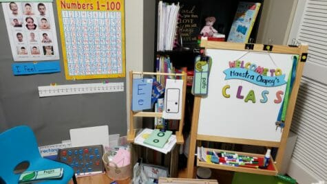 Corner in house with school materials and whiteboard with the word