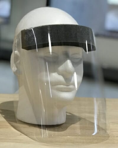 A clear plastic faceshield on a dummy.