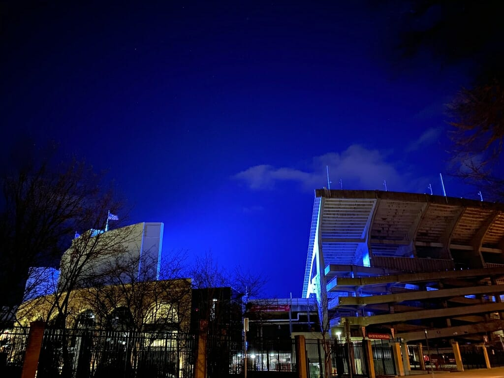 The blue light fills the space above Camp Randall Stadium.