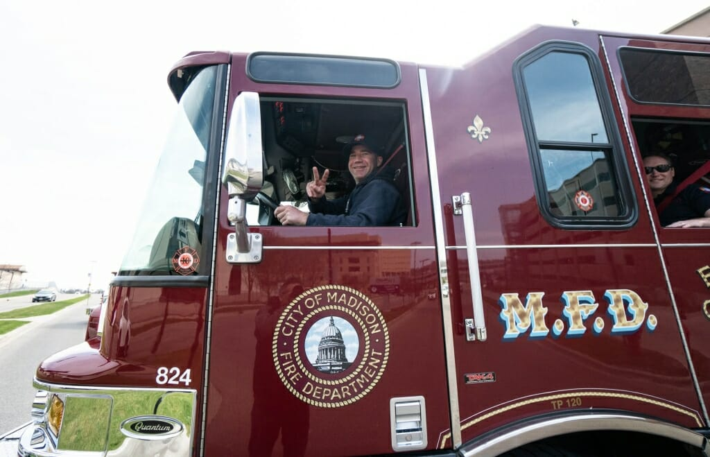 Closeup of fire truck driver making peace sign
