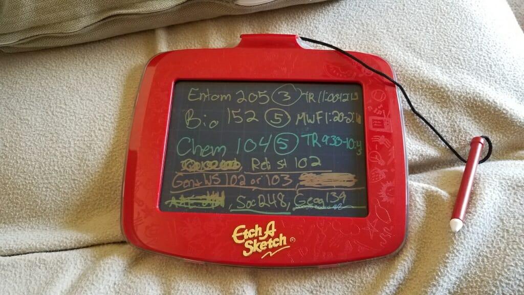 Class schedule written on an Etch A Sketch