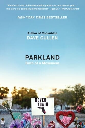 "Cover of book ""Parkland: Birth of a Movement"" showing sign saying ""NEVER AGAIN"" above a picture of a gun, in front of chain link fence with flowers on it"
