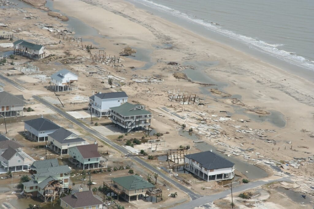 Aerial view of damaged buildings along coast