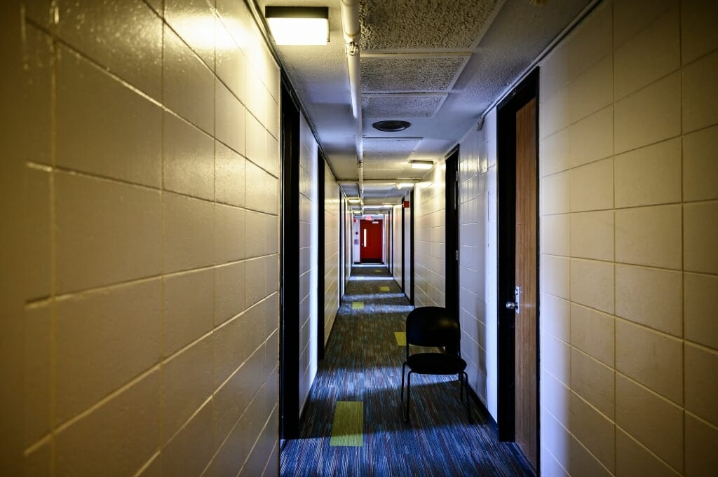 An empty hallway in a dorm.