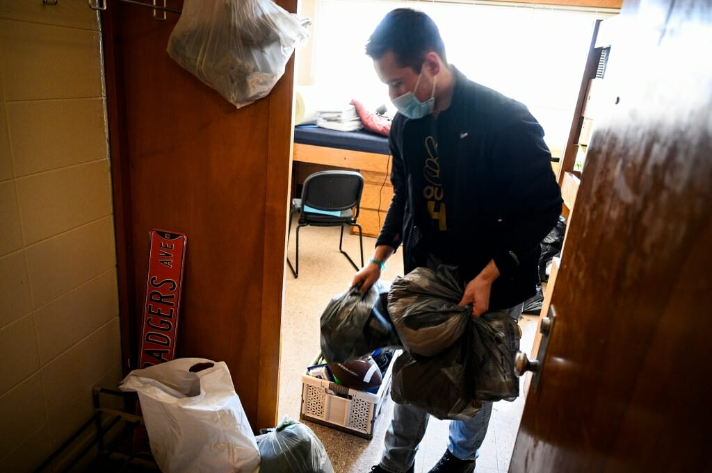 A student cleans out a room.