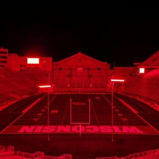 In a visual tribute honoring the graduating Class of 2020, Camp Randall Stadium glows in a bath of red light on Friday.