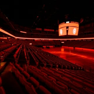 The Athletic Department used the Kohl Center's scoreboard, ring display and TV monitors to illuminate the arena in red.