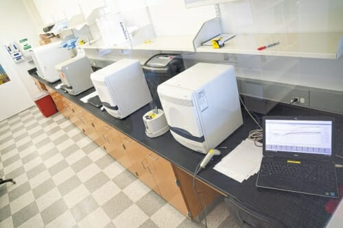 Lab equipment on a desk.