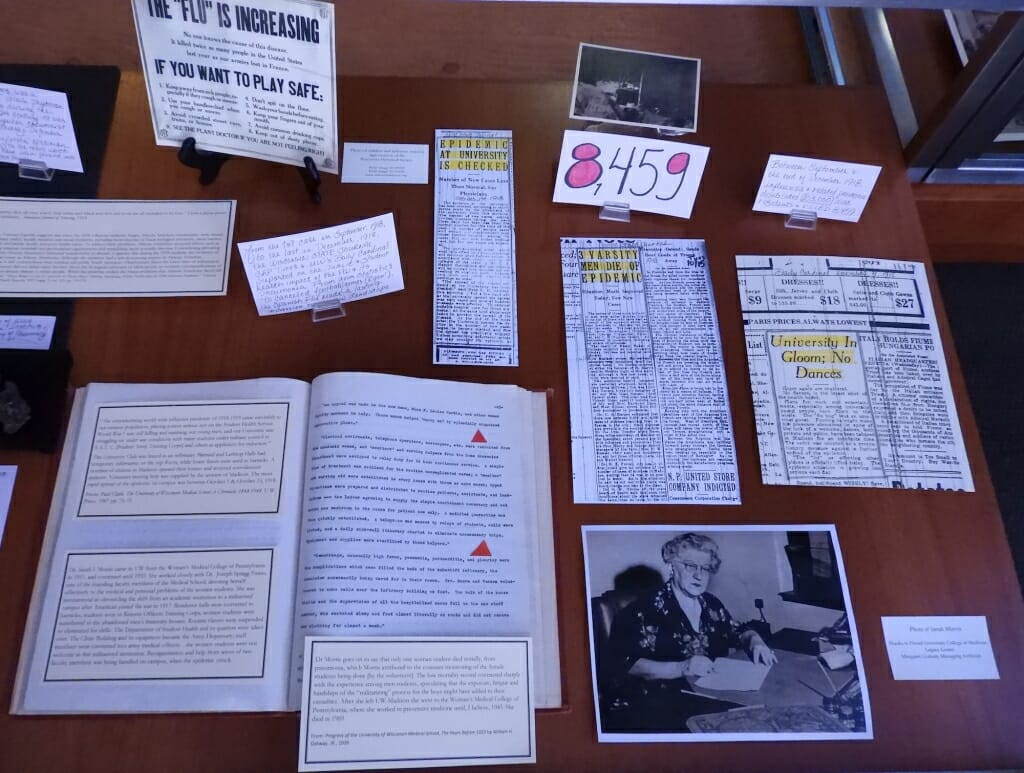 Books, photos and newspaper clippings in a display case
