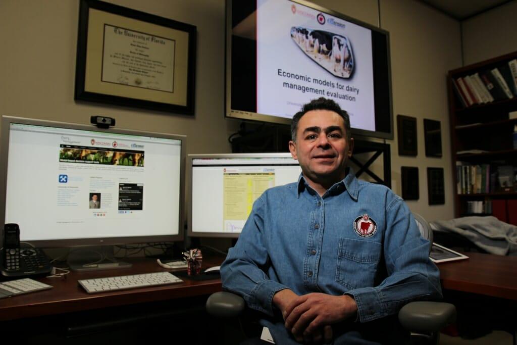 Cabrera sitting at desk with computer screens behind him