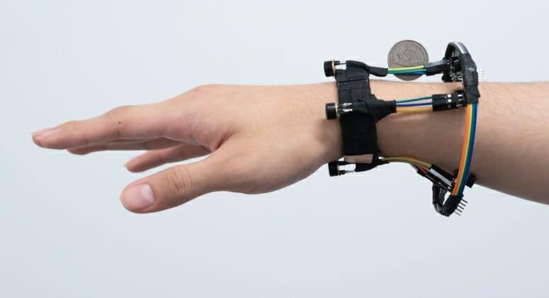 Closeup of hand with device worn around wrist