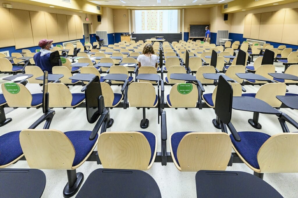 Students can sit in the spots marked with green stickers.