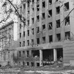 Exterior of Sterling Hall with windows blown out