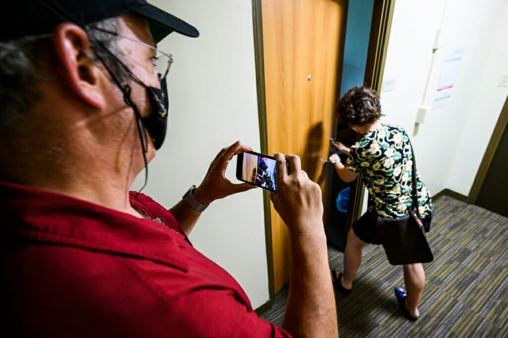 Todd Rosenberg records the moment his daughter Bella first opens her room door at Elizabeth Waters Residence Hall.