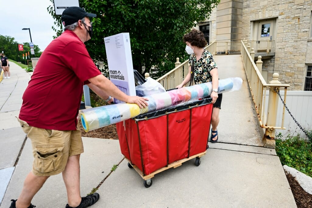 Todd Rosenberg and his daughter Bella roll her belongings up a ramp into Elizabeth Waters Residence Hall.