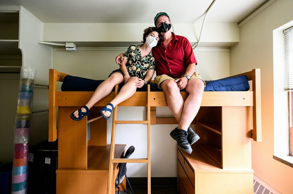 With the loft successfully built, Todd Rosenberg and his daughter Bella pose for photos on it.