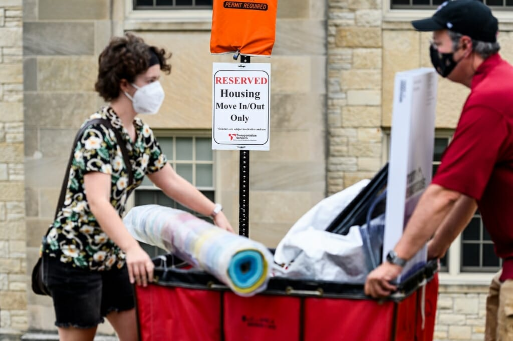 The residence hall move-in scene was a familiar one, but with the added complication of face masks and physical distancing because of the COVID-19 pandemic.