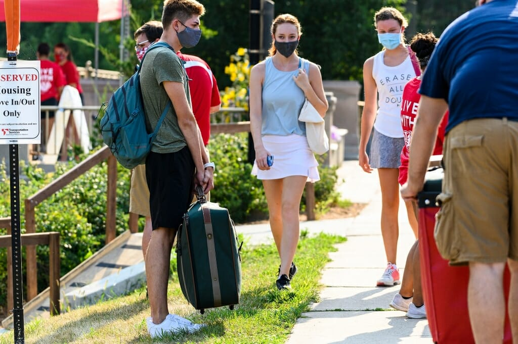 Students greet each other as they move in to Elizabeth Waters Residence Hall.