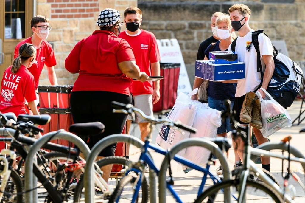 University Housing staff check in first-year  students moving in to Tripp-Adams Residence Hall.