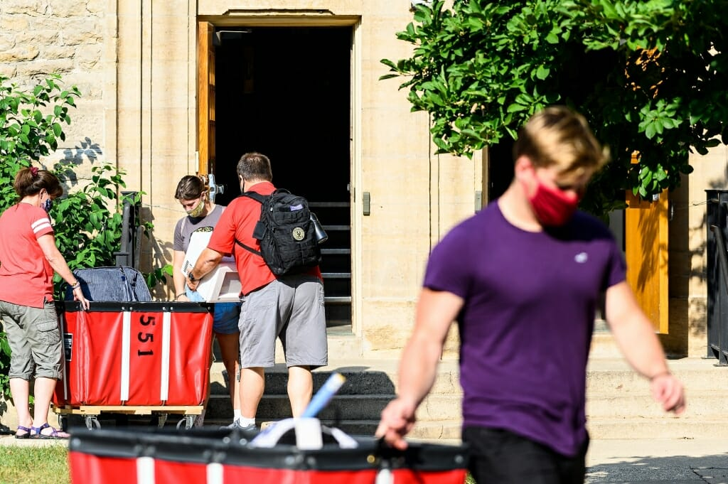 Students move into Tripp-Adams Residence Hall with the help of carts.