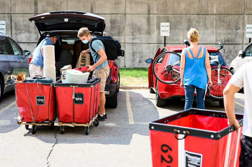 Family members are always willing to lend a hand on move-in day.