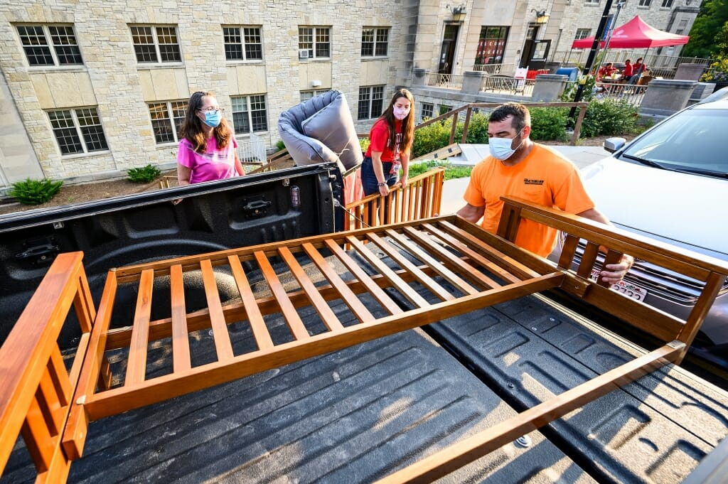 Vicki and Mark Chrostowski unload a futon frame for their daughter Maggie's room.