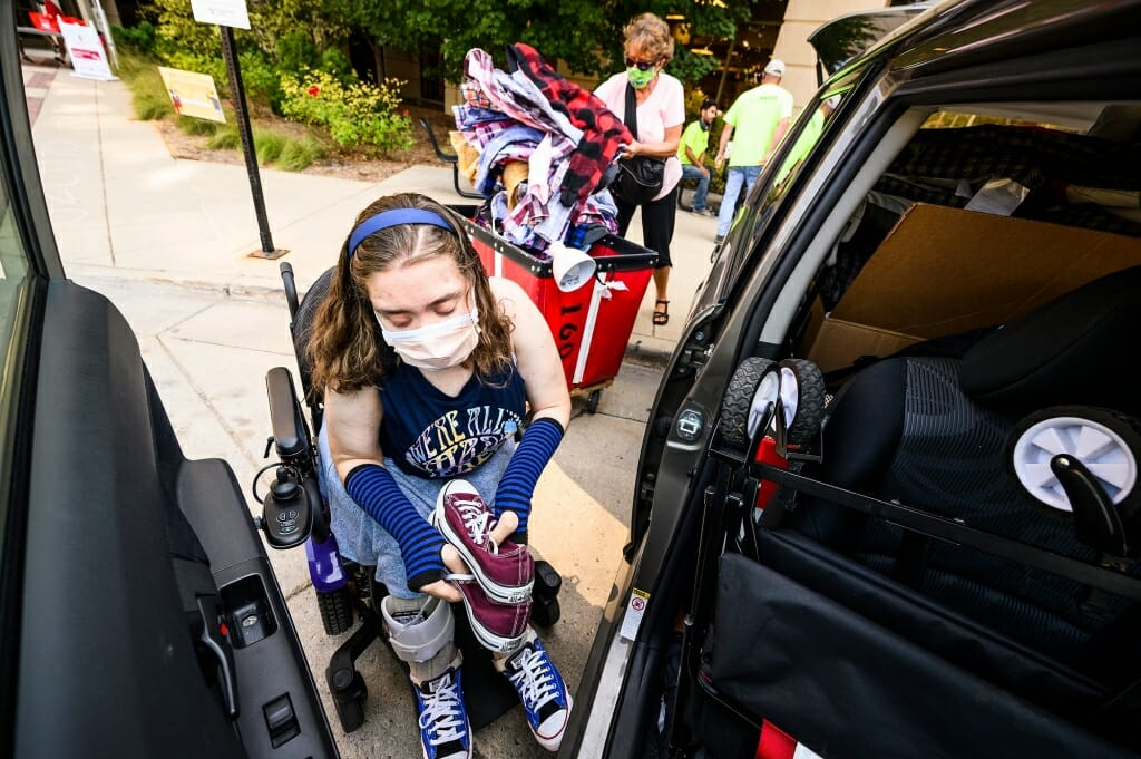 Maria Pesick of Wales, Wis., gathers her collection of Converse shoes while moving in to Smith Residence Hall.