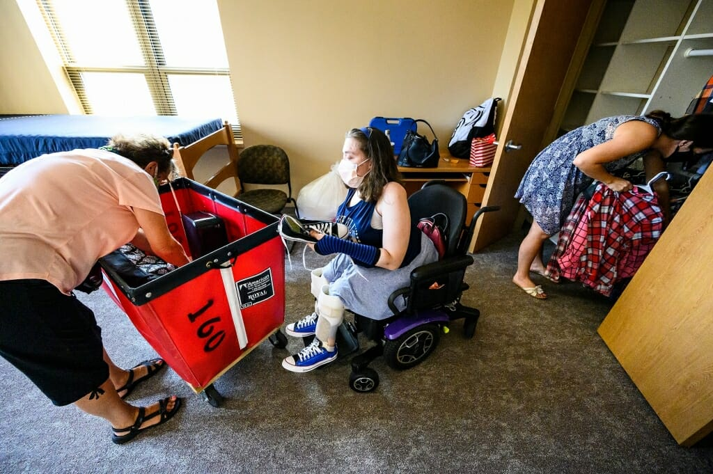 Maria Pesick of Wales, Wis., moves into a single-person room in Smith Residence Hall. Helping unpack is Maria's grandmother Terry McCabe, at left, and mother, Lisa Pesick, at right.