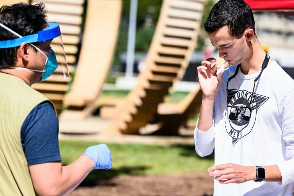 Zachary S submits saliva sample
