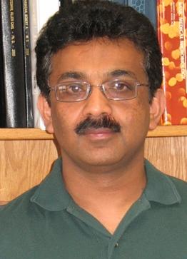 Portrait of Marulasiddappa Suresh standing in front of a bookshelf