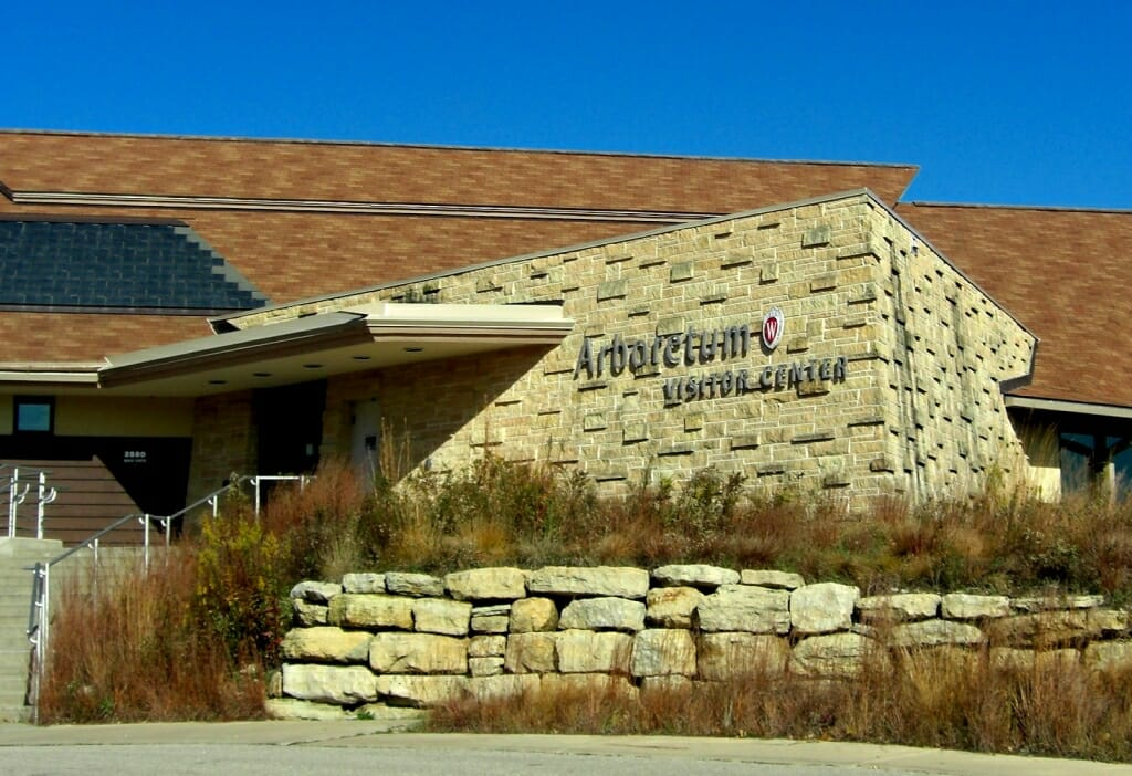 Exterior of main entrance to visitor center with rock wall and native plants