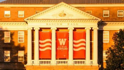 Closeup of Bascom Hall pillars with All Ways Forward banner