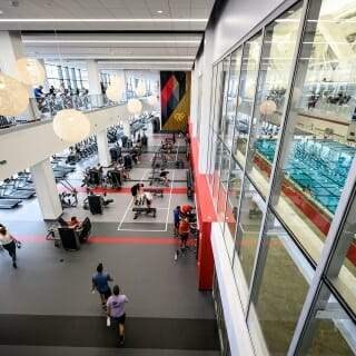 Students lift weights and work out in the strength equipment area (below) and cardio equipment area (above).