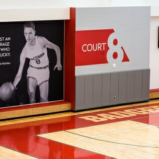 A wall mural of Ab Nicholas is pictured in one of the basketball court areas.