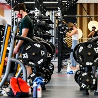 Students lift weight and work out in the third-floor strength area.
