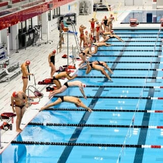 Members of the UW swim team meet for practice in the pool in the Soderholm Family Aquatic Center in The Nick.