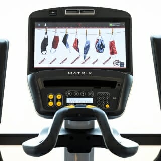 A Smart Restart campaign graphic is displayed on a cardio-equipment screen.