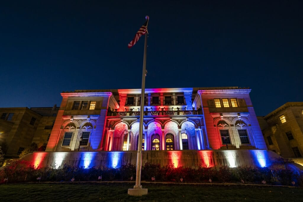 Memorial Union illuminated in red, white and blue lights