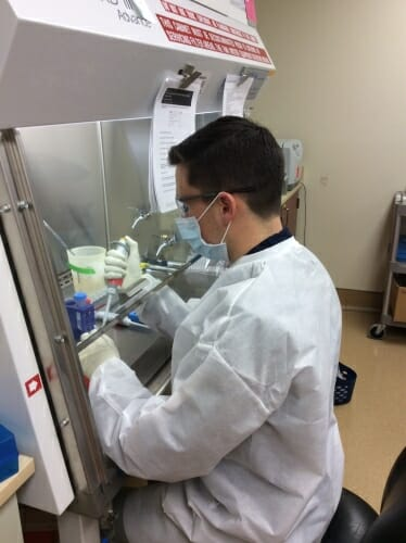 Gage Moreno working in a lab