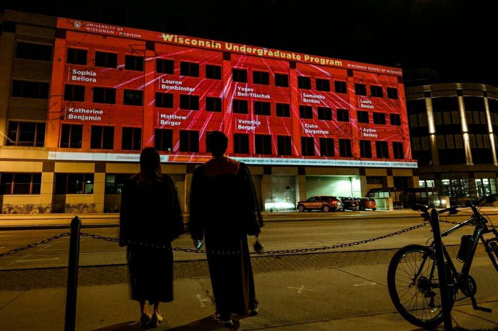 Building covered in red light and names