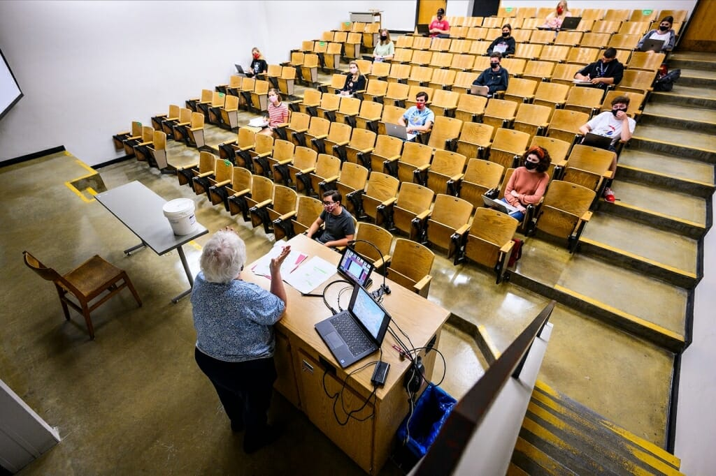 Lecture hall with a few students seated far apart