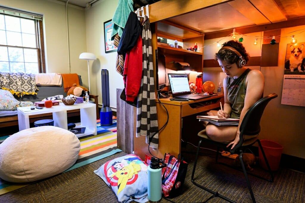 Student sitting in dorm room